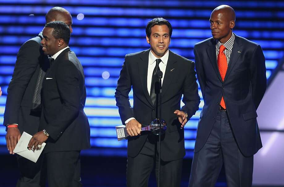 "Sean ""Diddy"" Combs presents the award to NBA coach Erik Spoelstra and NBA player Dwyane Wade onstage at The 2013 ESPY Awards. Photo: Frederick M. Brown"