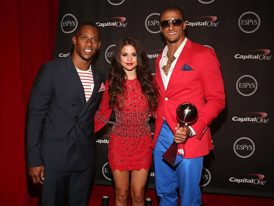 Wide receiver Victor Cruz, singer Selena Gomez, and 49ers quarterback Colin Kaepernick attend The 2013 ESPY Awards. Photo: Christopher Polk, Getty Images For ESPY