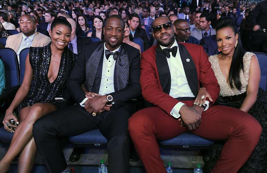 Gabrielle Union, left, and Dwyane Wade, center, LeBron James and Savannah Brinson are seen in the audience at the ESPY Awards. Photo: Jordan Strauss, Associated Press