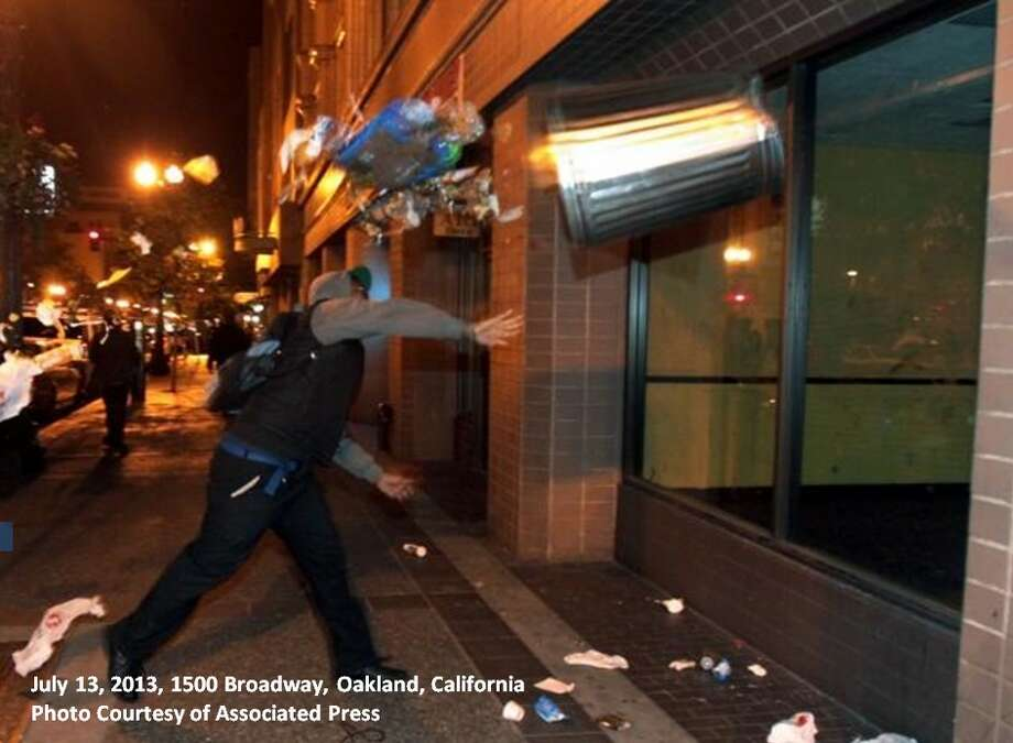 Oakland police are asking for help identifying this man, who broke an Oakland window with a trash can.