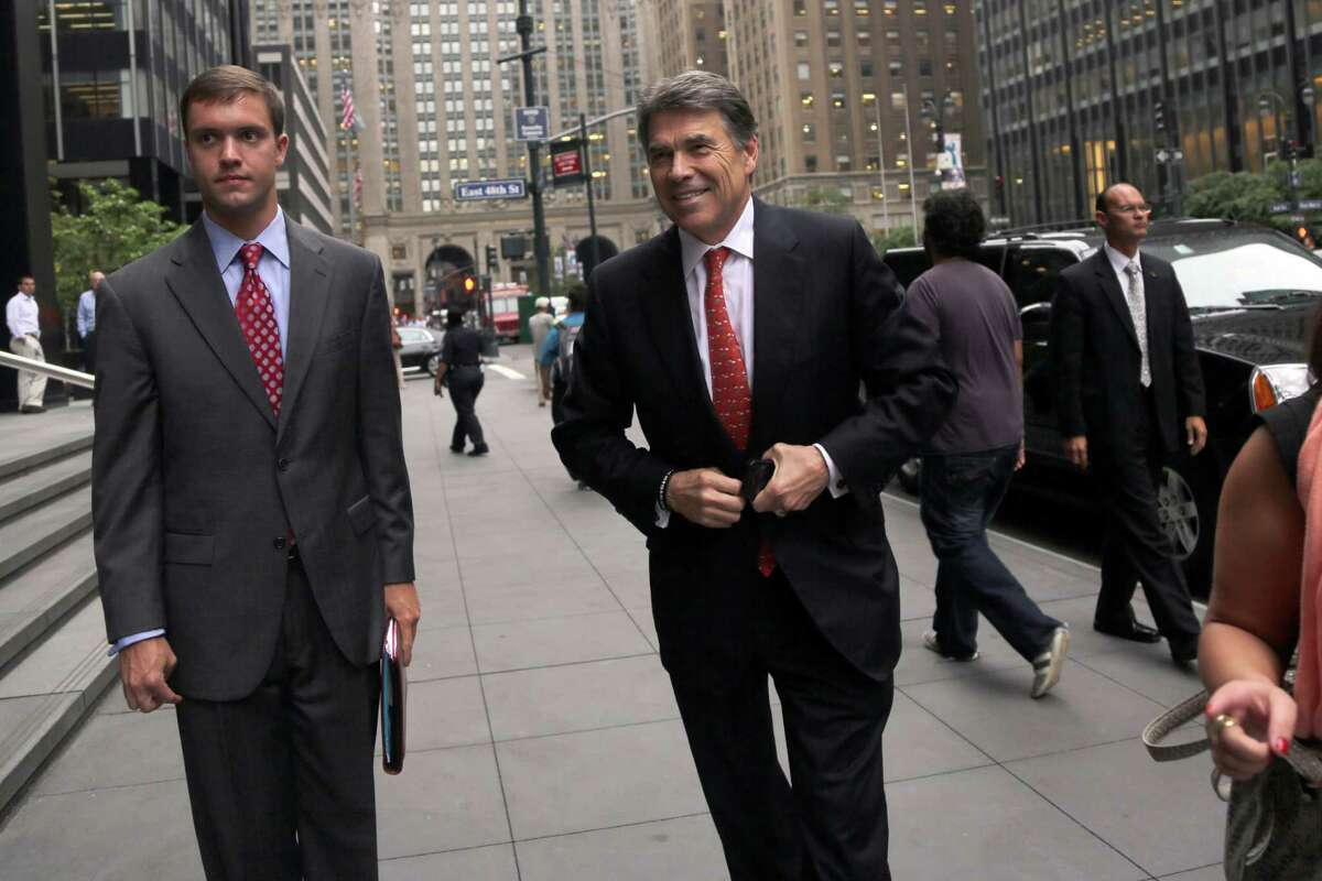 Texas Gov. Rick Perry arrives at a meeting in Midtown Manhattan, Tuesday, June 18, 2013 in New York. (AP Photo/Mary Altaffer)