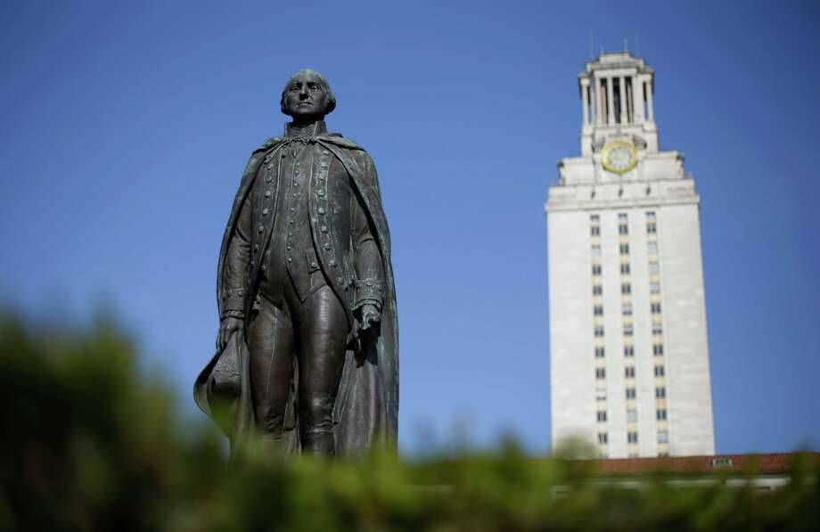 A statue of George Washington stands near the University of Texas Tower at the center of campus, Thursday, Nov. 29, 2012, in Austin, Texas.  If colleges were automobiles, the University of Texas at Austin would be a Cadillac: a famous brand, a powerful engine of research and teaching, a pleasingly sleek appearance. Even the price is comparable to the luxury car's basic model: In-state tuition runs about $40,000 for a four-year degree. (AP Photo/Eric Gay) Photo: Eric Gay, Associated Press / AP