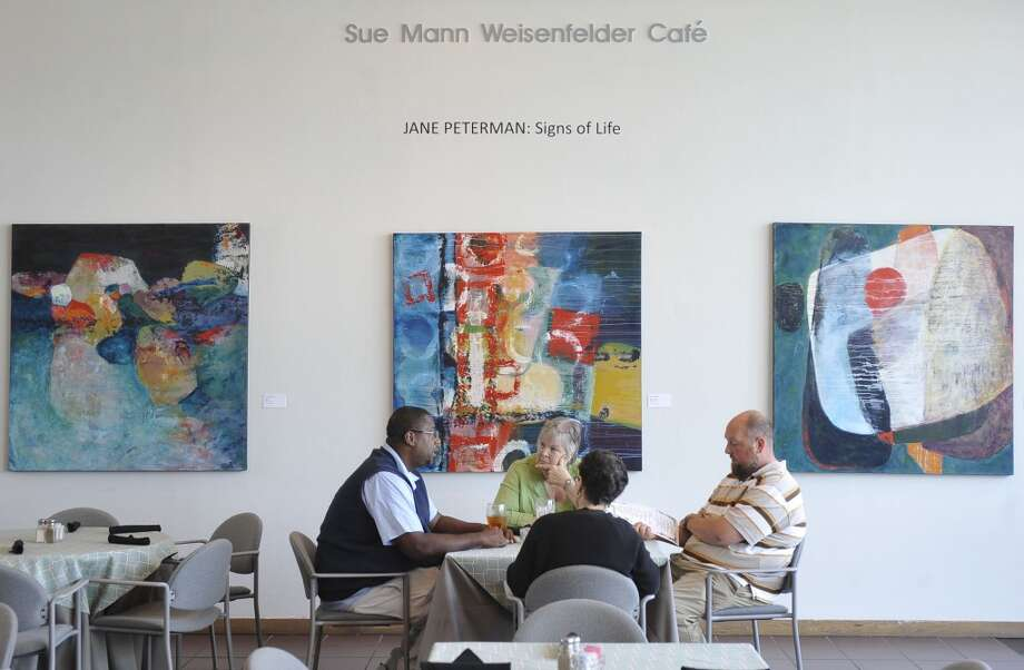 The Two Magnolias Cafe is located inside the Art Museum of Southeast Texas on Main Street in Beaumont. The walls currently have the works of Jane Peterman's exhibition titled Signs of Life hanging there.   Dave Ryan/The Enterprise