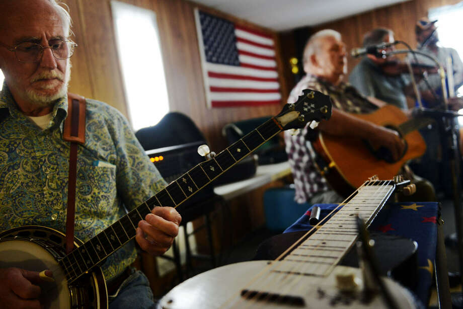 Dennis Spires (left), of the band Big Country, plays for attendees at the Henderson Square Dance in Henderson, W.Va. Photo: The Washington Post
