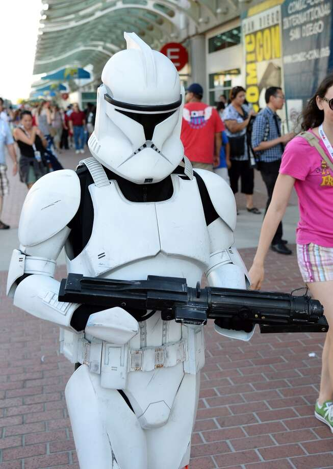 "Myke Soler of California walks outside the San Diego Convention Center dressed as a storm trooper from the ""Star Wars"" movie franchise during Comic-Con International 2013 on July 17, 2013 in San Diego, California.  (Photo by Ethan Miller/Getty Images)"