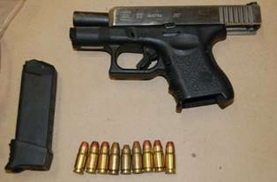 The State Police Gang Task Force executed a search and seizure warrant at 1020 Hancock Ave. Wednesday, July 18, 2013 and seized two handguns, along with cash and drugs. Antonio Small, 21, of that address, was arrested after jumping from a third-floor porch in an effort to escape police. Photo: Bridgeport Police Department