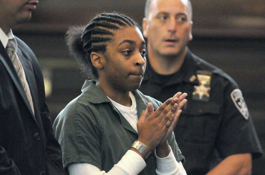 Keyanna Bradley, center, agrees to a plea agreement in the murder of Takim Smith before Judge Patrick McGrath Thursday morning, July 18, 2013, in Troy, N.Y.  (Michael P. Farrell/Times Union) Photo: Michael P. Farrell / 00023225A