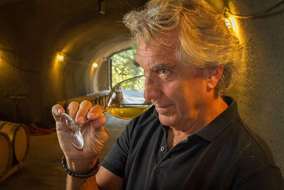 John Kongsgaard smells a glass of Chardonnay in his winery in Napa, Calif., on Wednesday, July 10th, 2013.