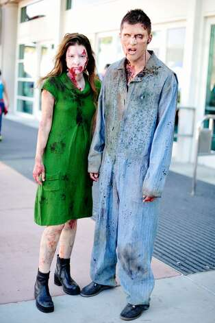 Comic Con goers dressed as Zombies for preview night of Comic-Con 2013 at San Diego Convention Center on July 17, 2013 in San Diego, California.  (Photo by Jerod Harris/Getty Images)