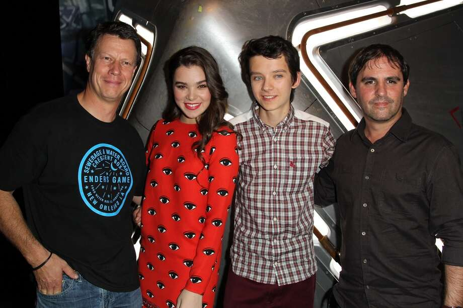 """(L-R) Gavin Hood,Hailee Steinfeld, Asa Butterfield and Bob Orci attend the """"Enders Game"""" Exclusive Fan Experience Press Preview Night - Comic-Con International 2013 on July 17, 2013 in San Diego, California.  (Photo by Jonathan Leibson/FilmMagic)"""