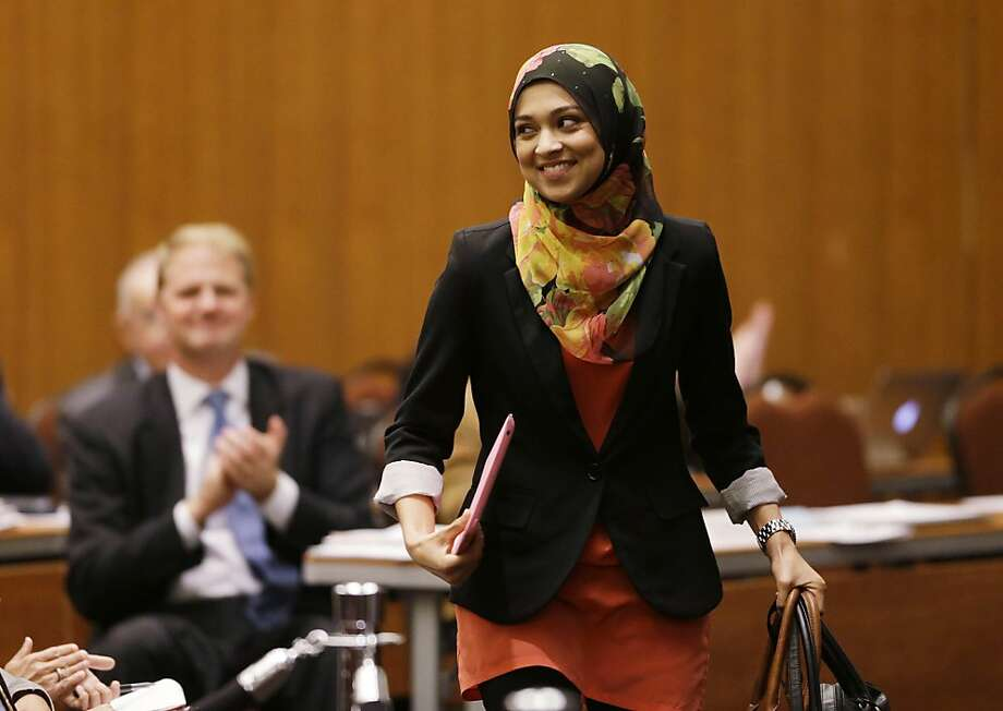 Sadia Saifuddin walks to take her chair after the UC Regents unanimously voted to confirm her as student regent Wednesday. Photo: Eric Risberg, Associated Press