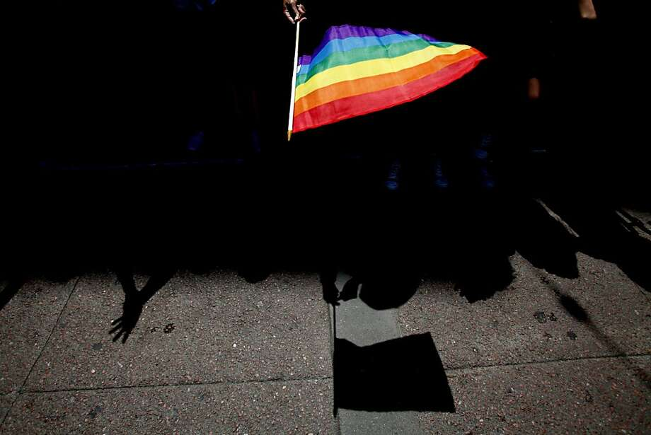 A spectator waves a flag during last month's Pride Parade in San Francisco. A bill protecting transgender youth awaits Gov. Jerry Brown's signature. Photo: Sarah Rice, Getty Images