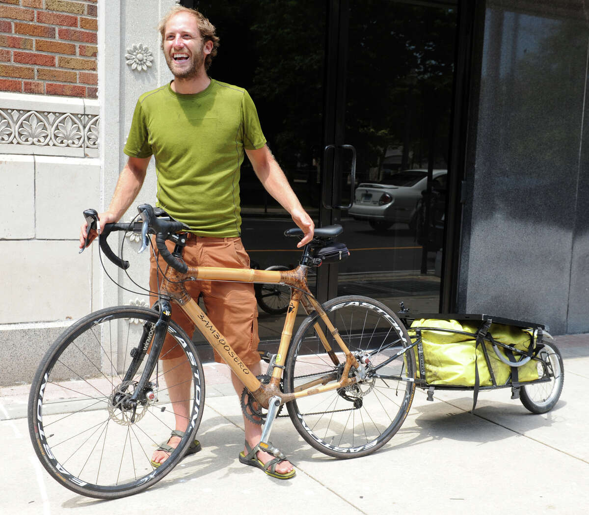 Rob Greenfield speaks during an interview in Bridgeport, Conn., July 18, 2013. Greenfield is in the process of riding his bicycle, which is made of bamboo, from San Francisco to Waitsfield, Vt., a journey of roughly 4,500 miles. Calling his trip Off the Grid Across America, it is meant to promote his lifestyle of environment awareness and adventure.