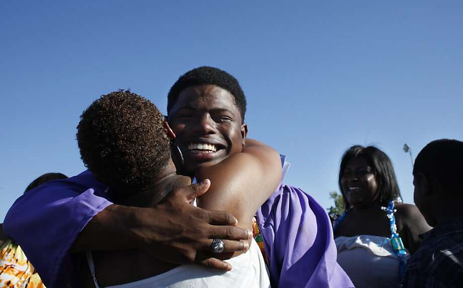 """Castlemont High graduate Thomas Logwood, being congratulated by his aunt Kelli Holms in Oakland, is part of The Chronicle series """"Even Odds."""" Photo: Lacy Atkins, The Chronicle"""