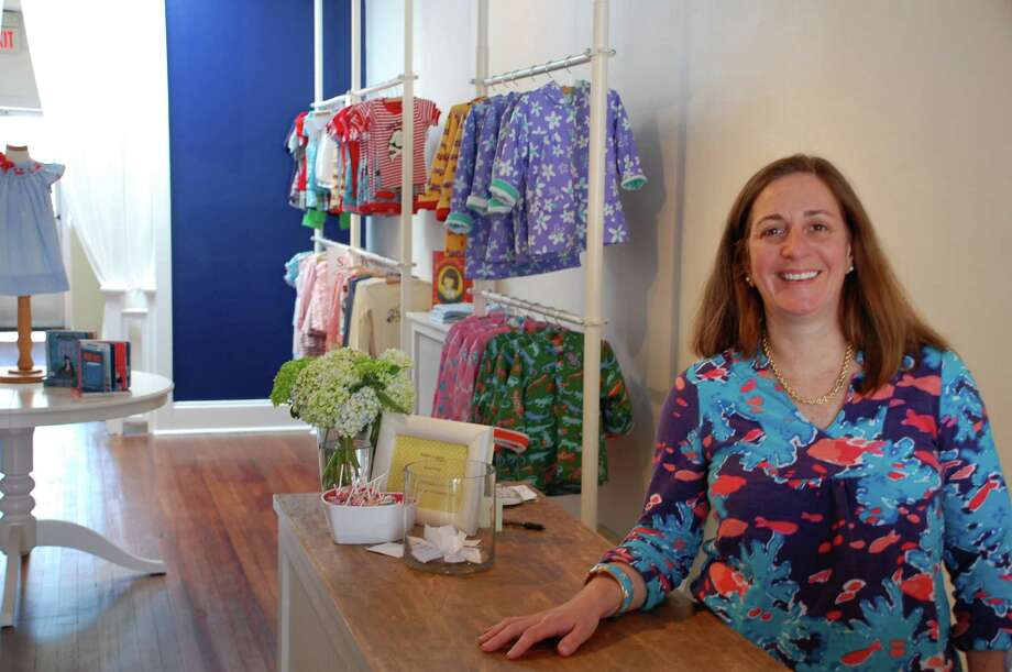 With a love for retail and years of experience, Darien resident Erica Wood opened Wiggles & Giggles, a new children's clothing store in Darien. Jarret Liotta/For the Darien News Photo: Contributed