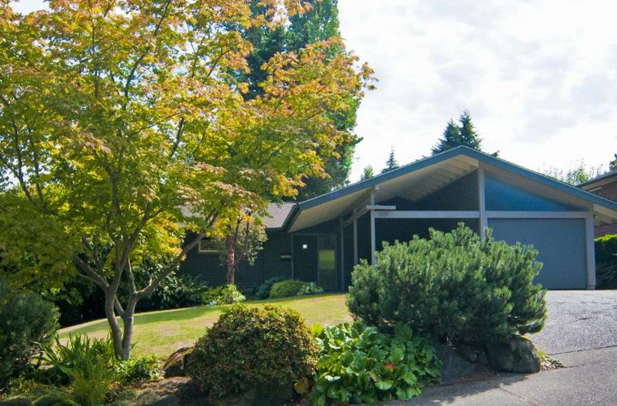 Paul Hayden Kirk is one of Seattle's best-known mid-century modern architects. Now, one of his creations, 1529 N.E. 90th St., in Maple Leaf is listed for a reasonable price, by Seattle standards, $650,000. Kirk was born in Salt Lake City, in 1914, moved to Seattle at age 8, graduated from Roosevelt High School in 1932 and earned his architecture degree from the University of Washington in 1937, according to the mid-century modern architecture website docmomo wewa (Documentation and Conservation of the Modern Movement, Western Wa.). He worked for several architects before starting his own firm in 1939 and designing homes for his older brother, Blair Kirk, who was a contractor. Notable Kirk buildings include the University Unitarian Church, the Frank Gilbert residence at The Highlands, Intiman Playhouse, the Magnolia Branch Library, the Japanese Presbyterian Church, and, at the University of Washington, the Faculty Club (with Victor Steinbrueck), Odegaard Library, and Meany, Haggett and Balmer halls, according to AIA Seattle. Kirk retired in 1979 and died on May 22, 1995. The Maple Leaf house, built in 1952, is 2,260 square feet, with three bedrooms, 1.75 bathrooms, vaulted wood ceilings, wood-paneled walls, walls of windows, two fireplaces, a rec room, an outdoor hot tub and patios on a landscaped, 9,570-square-foot lot.