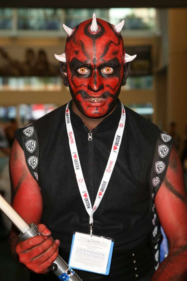 A fan attends day 1 of Comic-Con International on July 17, 2013 in San Diego, California.