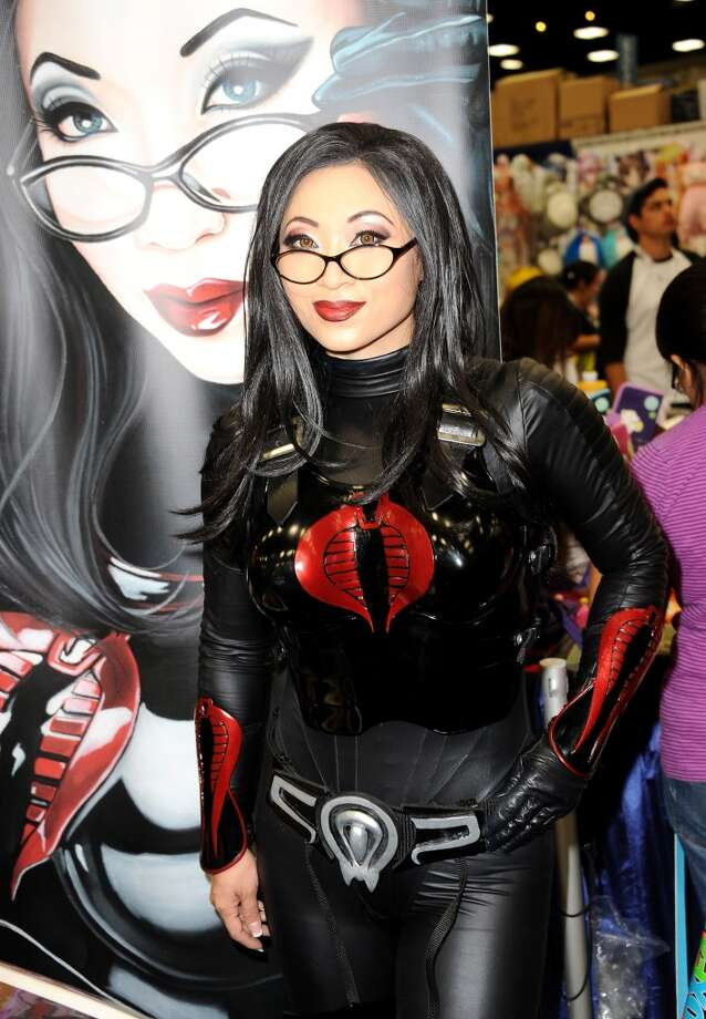 Festival goers attend Comic-Con International at San Diego Convention Center on July 18, 2013 in San Diego, California.