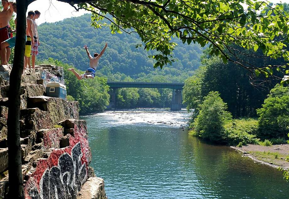 "Geronimo!A teenager leaps off ""The Rock"" and into the Schuylkill River near Port 