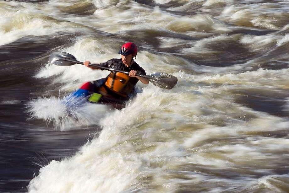 Up a swift creek with a paddle: David Wei pilots his freestyle kayak on whitewater from a release of water at the Falls 