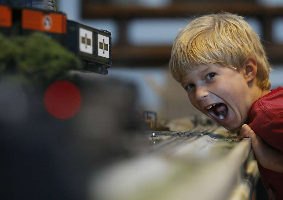 Stop the train! There's a little boy on the tracks! Seven-year-old Andrew Hutcherson goes loco for Lionels at the Lionel Model Train Convention in Chattanooga, Tenn. Photo: Doug Strickland, Associated Press