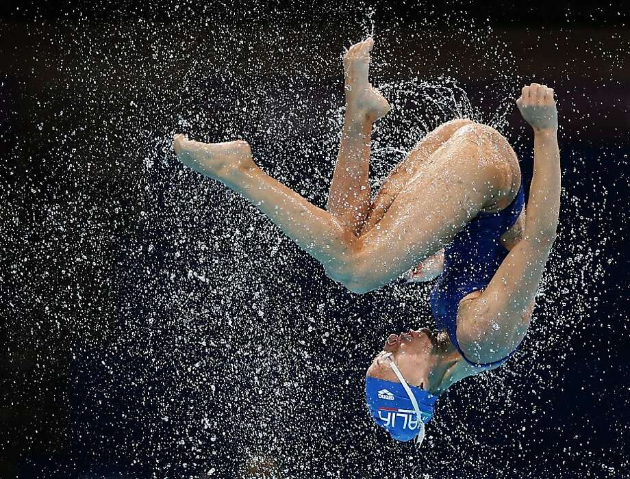 Making a splash in Spain: An Italian synchronized swimmer is thrown into the air during a training session ahead of the FINA Swimming World Championships in Barcelona. Photo: Michael Sohn, Associated Press