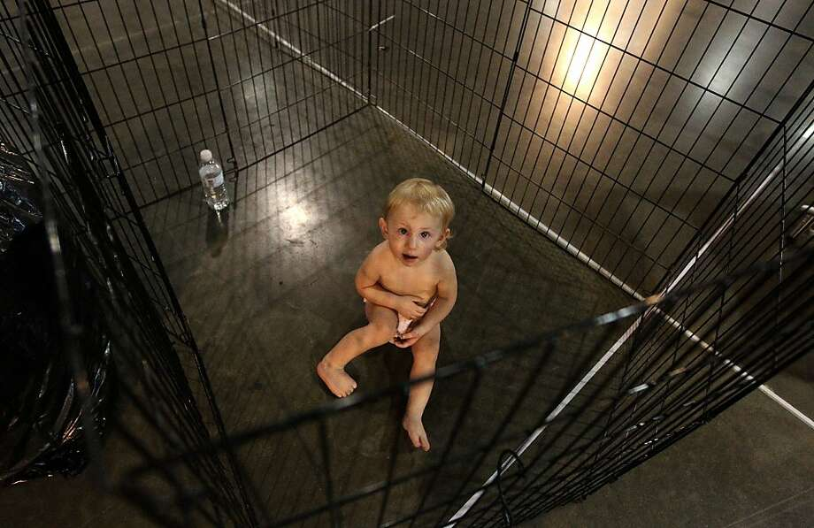 Can I get out early for good behavior?While Mom's preparing her Norwegian Elk Hound for the Reliant Park World Series of Dog Shows in Houston, 19-month-old Nora Bliss Bettandorff waits in the pen normally used by the canine. Photo: Karen Warren, Houston Chronicle