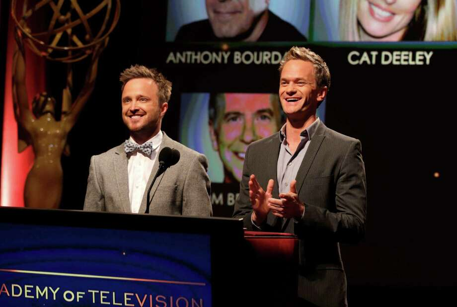 Actors Aaron Paul, left, and Neil Patrick Harris announce nominations at the 65th Primetime Emmy Nominations Announcements at the Leonard H. Goldenson Theatre at the Academy of Television Arts & Sciences, Thursday, July 18, 2013, in North Hollywood, Calif. (Photo by Todd Williamson/Invision/AP) ORG XMIT: CASH104 Photo: Todd Williamson / Invision