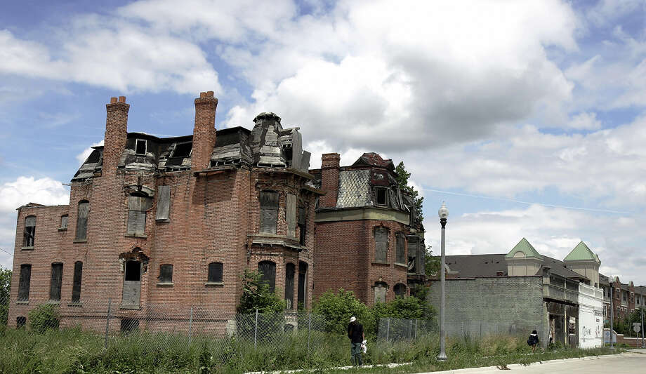 There are more than 12,000 abandoned homes in the Detroit area, a byproduct of decades of layoffs at the city's auto plants and people leaving for the suburbs. And despite scores of attempts by government and civic leaders to set the city straight, the automobile capital of the world seems trapped in a vicious cycle of urban decay. Photo: JEFF HAYNES, AFP/Getty Images / 2005 AFP
