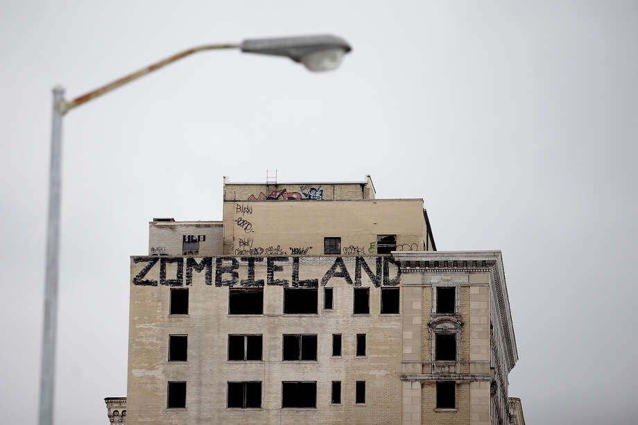 Graffiti covers an abandoned building February 24, 2013 in Detroit, Michigan. The city of Detroit has faced serious economic challenges in the past decade, with a shrinking population and tax base while trying to maintain essential services. Photo: J.D. Pooley, Getty Images / 2013 Getty Images