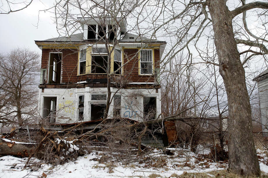 An abandoned home is seen on February 24, 2013 in Detroit, Michigan. Photo: J.D. Pooley, Getty Images / 2013 Getty Images