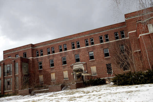 An abandoned hospital is seen February 24, 2013 in Detroit, Michigan. Photo: J.D. Pooley, Getty Images / 2013 Getty Images