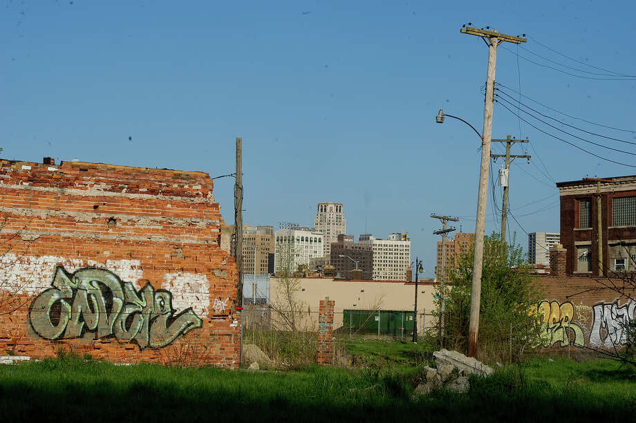 An abandoned building sits against the Detroit city skyline along Grand River Avenue on May 1, 2013 in Detroit, Michigan. Photo: Christian Science Monitor, Christian Science Monitor/Getty  / 2013 The Christian Science Monitor