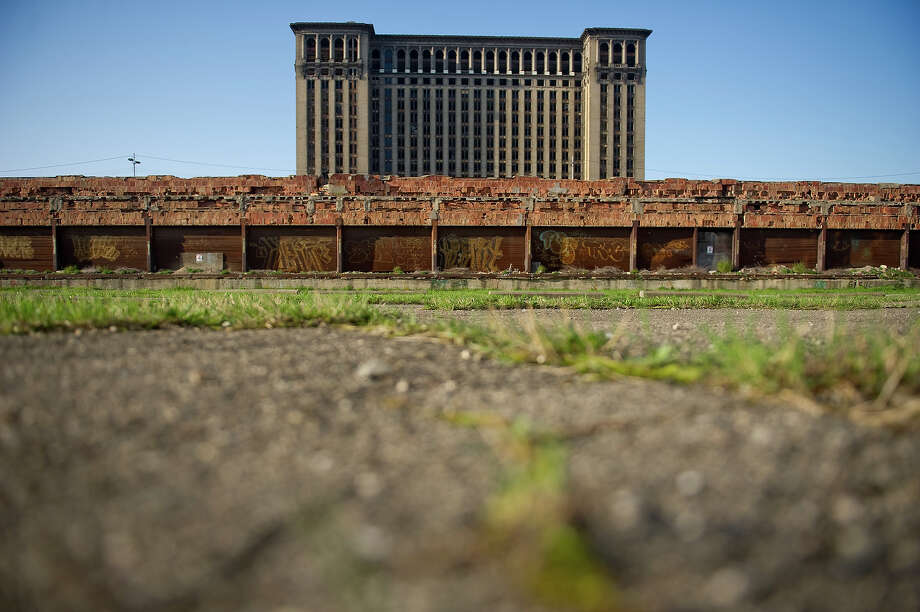 The back of the abandoned Michigan Central Station on May 1, 2013 in Detroit, Michigan. The station was opened in 1913, closed in 1988, and has fallen into disrepair since. Photo: Christian Science Monitor, Christian Science Monitor/Getty  / 2013 The Christian Science Monitor