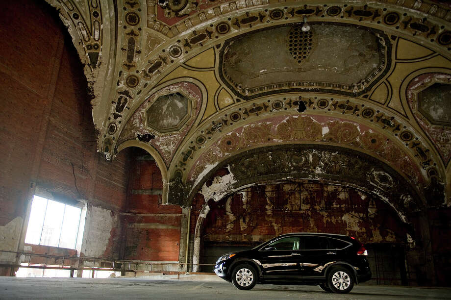 Cars park in the former theater of The Michigan Building on May 1, 2013 in downtown Detroit, Michigan. The Michigan Theater was opened in 1926 and then gutted in the late 1970s and turned into a parking garage. Photo: Christian Science Monitor, Christian Science Monitor/Getty  / 2013 The Christian Science Monitor