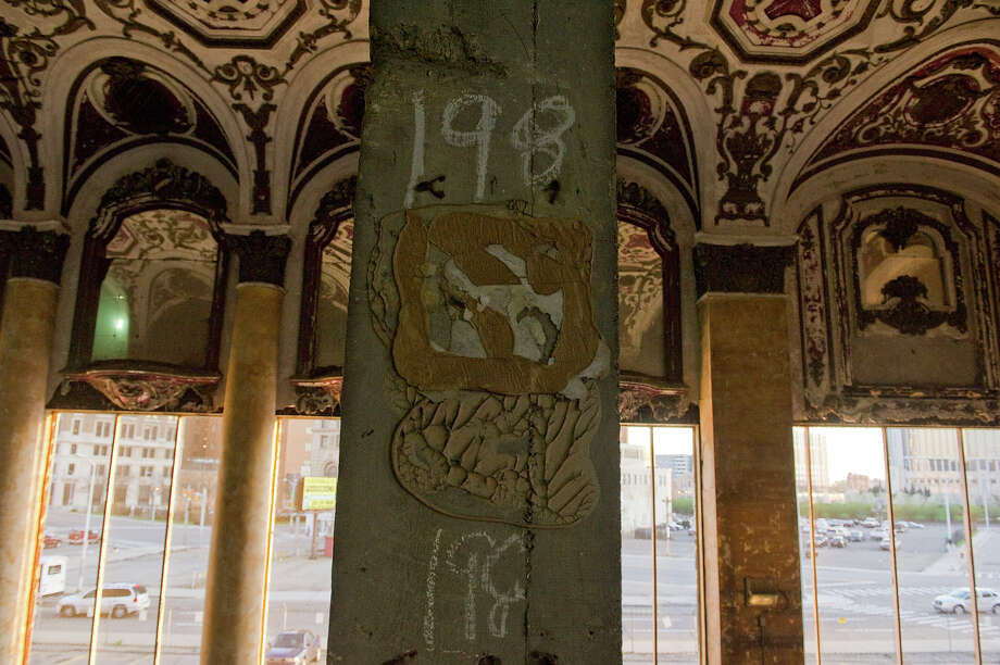 Details of the auditorium's ceiling of the former theater of The Michigan Building remain intact on May 1, 2013 in downtown Detroit, Michigan. The Michigan Theater was opened in 1926 and then gutted in the late 1970s and turned into a parking garage. Photo: Christian Science Monitor, Christian Science Monitor/Getty  / 2013 The Christian Science Monitor