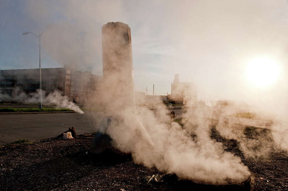 Steam rises from a manhole at dawn among abandoned buildings and factories along East Warren Avenue on May 2, 2013 in Detroit, Michigan. Photo: Christian Science Monitor, Christian Science Monitor/Getty  / 2013 The Christian Science Monitor