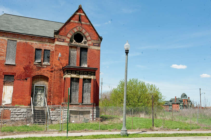 old victorian style homes sit vacant in the brush park