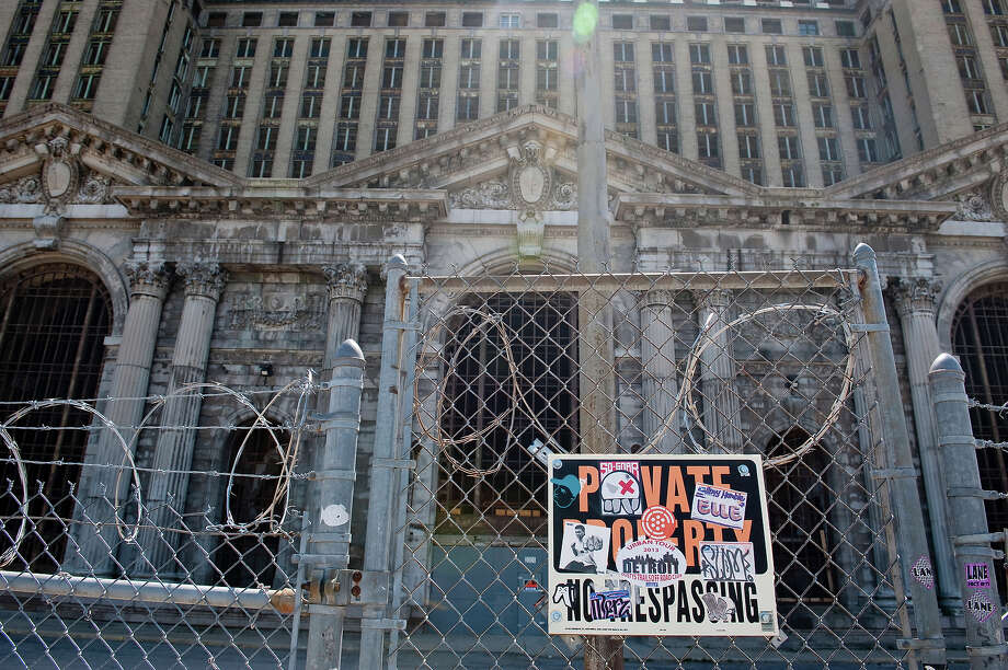 Barbed wire blocks the entrance of the abandoned Michigan Central Station on May 2, 2013 in Detroit, Michigan. The station was opened in 1913, closed in 1988, and has fallen into disrepair since. Photo: Christian Science Monitor, Christian Science Monitor/Getty  / 2013 The Christian Science Monitor