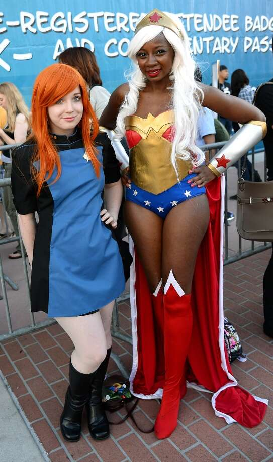 "Rachel Elsten (L) of California, dressed as a character from ""Star Trek,"" and Chaka Cumberbatch of Texas, dressed as Wonder Woman, pose outside the San Diego Convention Center during Comic-Con International 2013 on July 17, 2013 in San Diego, California."