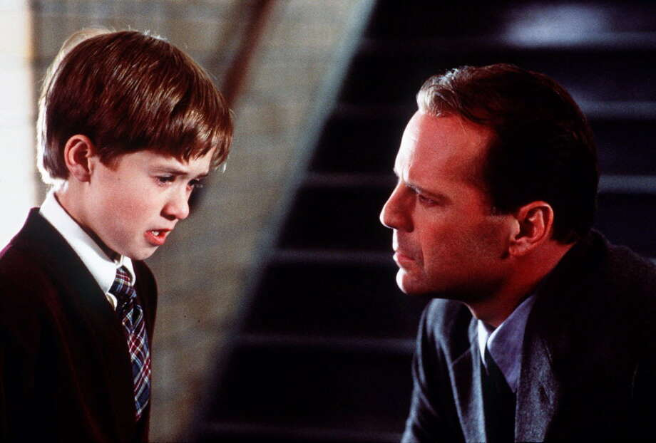 "Don't spoil this: Haley Joel Osment, left, and Bruce Willis in ""The Sixth Sense"" (AP Photo/Spyglass Entertainment, Ron Phillips, File)"