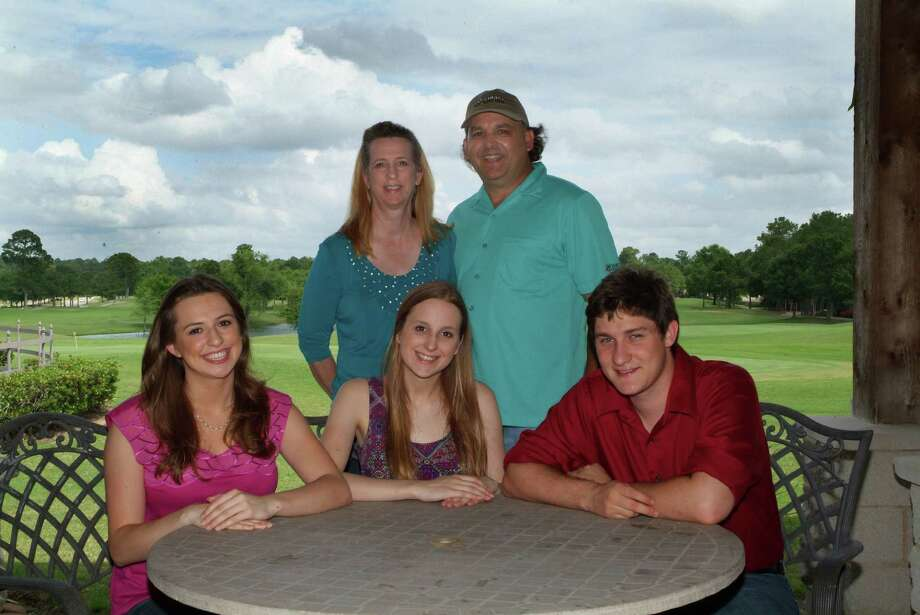 David Preisler and his wife Debbie, owners of the Oakhurst Golf Club, are shown with their college-age daughter Rachel and soon-to-be-married daughter, Sara, and her fiancé, Josh.