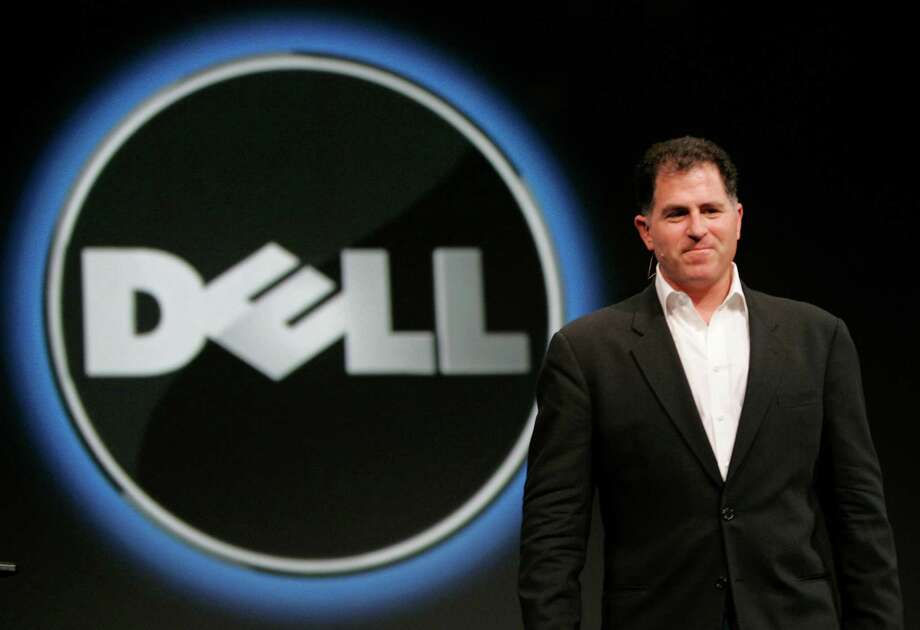 FILE - In this Wednesday, Nov. 14, 2007 file photo, Dell CEO Michael Dell smiles at Oracle Open World conference in San Francisco.  Dell Inc. is making a late push to win shareholder support for founder Michael Dell's plan to take the slumping computer maker private, an indication that the scheduled vote, Thursday, July 18, 2013, could be close. Supporters of the $24.4 billion buyout believe Dell Inc. stands a better chance of turning around if it can make long-term strategic decisions without worrying about meeting Wall Street's quarter-to-quarter expectations. (AP Photo/Paul Sakuma, File) ORG XMIT: NYBZ152 Photo: Paul Sakuma / AP