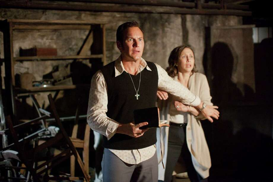 "In this publicity image released by Warner Bros. Pictures,  Patrick Wilson portrays Ed Warren, left, and Vera Farmiga portrays Lorraine Warren in a scene from ""The Conjuring."" (AP Photo/New Line Cinema/Warner Bros. Pictures, Michael Tackett) ORG XMIT: NYET264 Photo: Michael Tackett / New Line Cinema/Warner Bros. Pictures"