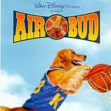 """Air Bud"" - After his father dies, Josh Framm (Kevin Zegers) adopts Buddy, an abandoned dog, just as the boy and his mother move to a new town. Too shy to play basketball, Josh instead manages the team but one night discovers that Buddy can sink hoops. Soon, Buddy's skills inspire the team, helping take them all the way to the championships in director Charles Martin Smith's family comedy that tackles loneliness, hope, wonder -- and a most unusual pet. Available Aug. 1"