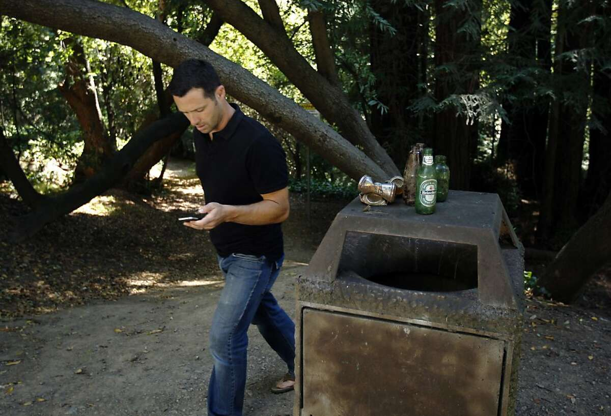 Jeff Kirschner at Sausal Creek where he was first inspired to start Litterati.org, a website designed to encourage people to pick up litter. All one has to do is take a picture on instagram and tag it #litterati and it will be uploaded to litterati.org. Wednesday, July 03, 2013 in Oakland, Calif. Kirschner was inspired to start Litterati when his 5 year old-daughter Tali spotted a bucket for cat-litter lying in the creek and commented, 'that's not supposed to be there daddy.'