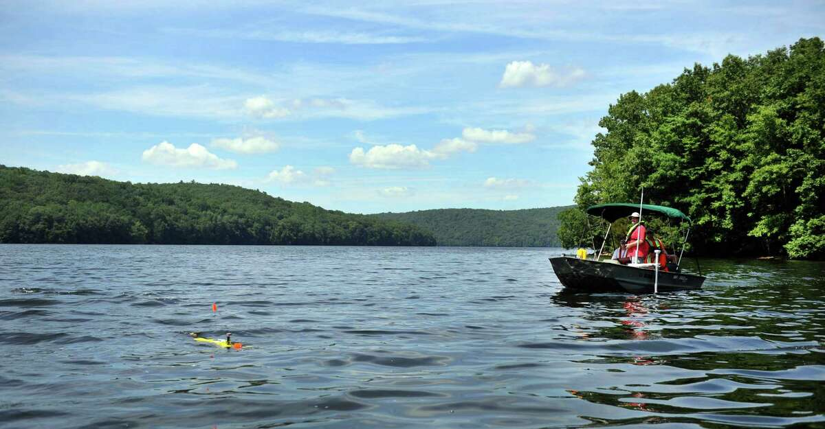 A group with the US Geological Survey out of East Hartford, Conn., test the waters of Lake Lillinonah Monday, July 15, 2013.
