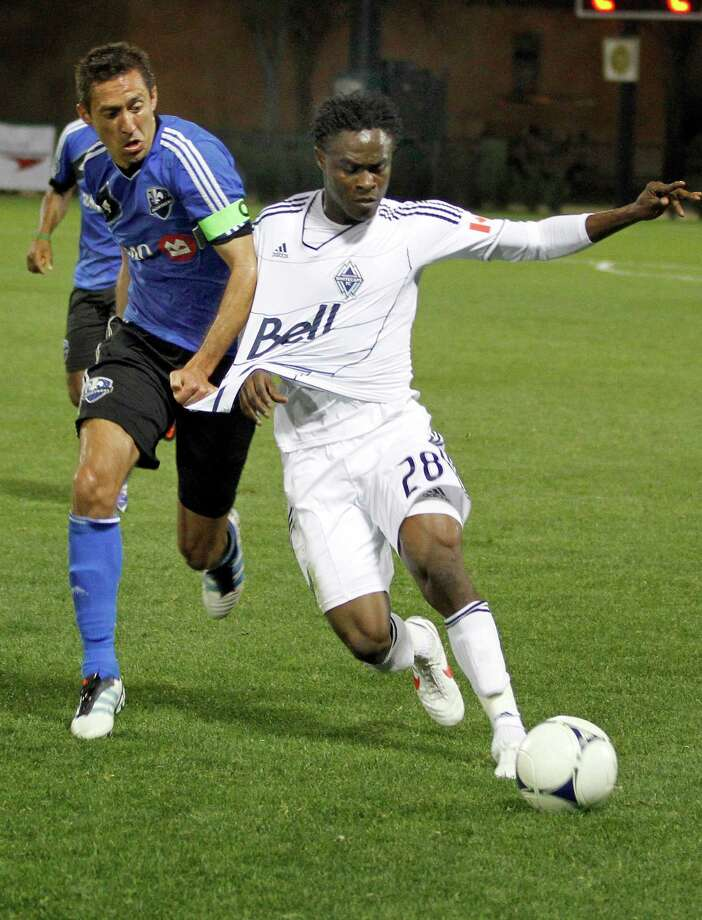 Montreal midfielder Davy Arnaud blocks Vancouver midfielder Gershon Koffie (28) during a soccer match at the Walt Disney World Pro Soccer Classic on Friday, Feb. 24, 2012, in Lake Buena Vista, Fla. Photo: The Associated Press, FRE / AP2012