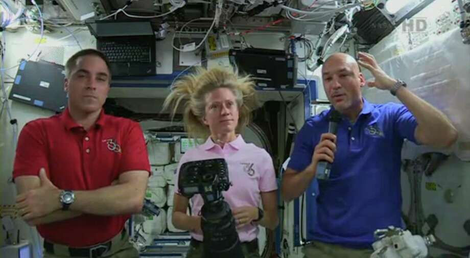 Italian astronaut Luca Parmitano, right, describes the water in his helmet on Tuesday's spacewalk with U.S. astronaut Chris Cassidy during a news conference with U.S. astronaut Karen Nyberg on the Space Station. Photo: HOPD / NASA