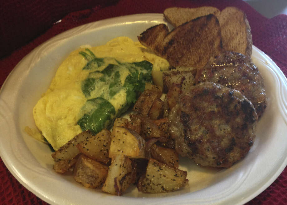 House-made pork sausage accompanies a spinach omelet at Mac & Ernie's Roadside Eatery in Tarpley. Photo: Courtesy Photo